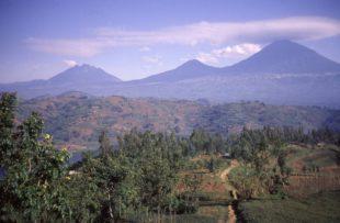 Cloud cap of lenticular clouds over the Virunga Mountains Volcanoes of Sabyinyo Gahinga Muhabura in northwest Rwanda Central Africa
